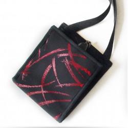 Ti Sac Rouge Brillant, une pochette soirée avec ses paillettes aux effets colorés