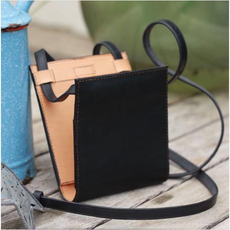 Un sac de créateur en cuir d'exception au design minimaliste, confectionné par un artisan d'Art sculpteur sur cuir - Made in Fra